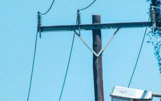 power-pole-vandalism-leaves-migrant-camp-in-darkness