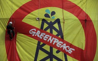 greenpeace-activists-abseil-down-helpe-storage-tank-to-protest-amp-8216-climate-emergency-amp-8217