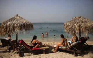 greeks-return-to-beaches-in-heatwave-but-keep-their-umbrellas-apart