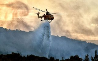 homes-evacuated-near-athens-as-wind-fuels-wildfire