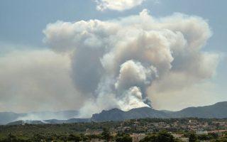 firefighters-battle-forest-blaze-near-seaside-village