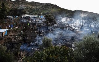 small-fire-burns-tents-in-squalid-greek-island-refugee-camp0