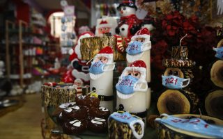santa-candles-get-masked-up-in-greece-in-covid-19-surge