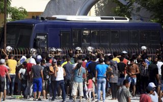 greece-mulls-racism-charges-as-migrants-targeted