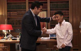 greek-pm-hosts-afghan-boy-11-whose-home-was-targeted-by-racist-vandals