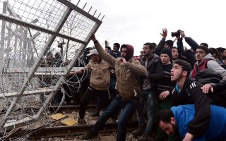 as-europe-bickers-police-fire-tear-gas-on-migrants-storming-border