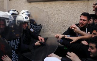 protesters-police-clash-over-auctions