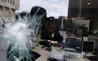 offices-of-ethniki-insurance-attacked-with-sledgehammers