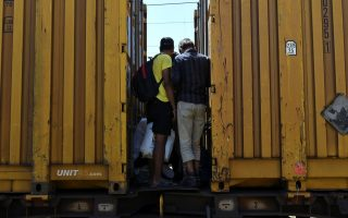 migrant-stowaways-ride-greek-freight-trains-seeking-escape-to-north