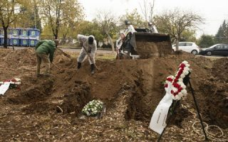 in-greek-city-segregated-graves-extend-covid-19-isolation