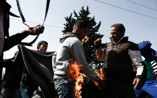 two-migrants-try-to-set-themselves-on-fire-in-protest-at-border-shutdown0
