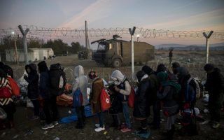 migrants-stuck-in-greek-makeshift-camp-vow-to-stay-put