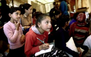 greece-to-begin-schooling-migrant-children-next-week-minister-says