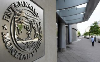 imf-says-greece-made-overdue-payments-no-longer-in-default