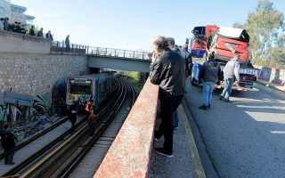 car-falls-off-bridge-onto-rail-tracks