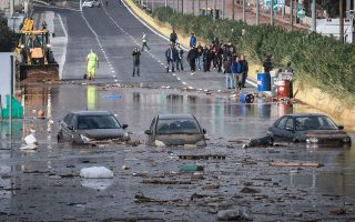 two-dead-as-downpour-near-athens-floods-roads-traps-residents