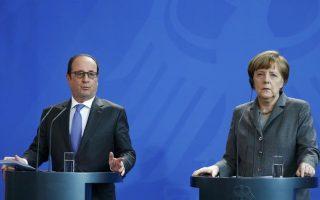 hollande-merkel-stress-migrant-crisis-needs-eu-solution