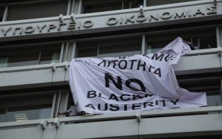 banner-against-austerity-in-athens-taken-down