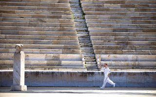 olympic-flame-starts-an-uncertain-journey