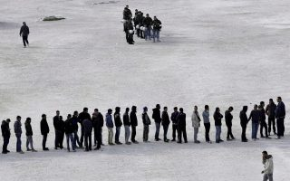 refugees-line-up-for-food-at-tae-kwon-do-stadium