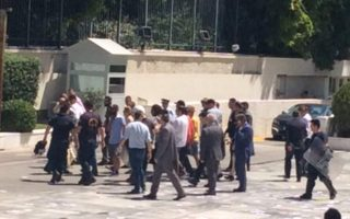 rouvikonas-members-enter-parliament-amp-8217-s-courtyard