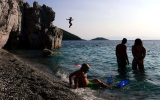 tourists-enjoy-the-sea-at-hovolo-beach-on-the-island-of-skopelos