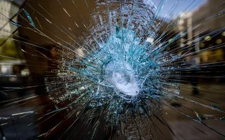 vandals-use-sledgehammers-to-smash-glass-fronts-of-banks-in-central-athens