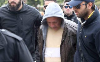 tax-officer-murder-suspect-attacked-outside-athens-courthouse