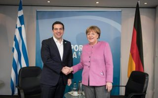 tsipras-merkel-discuss-cyprus-turkey-refugee-agreement-over-the-phone0