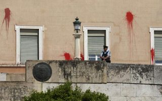 rouvikonas-member-who-allegedly-hurled-paint-at-parliament-is-released