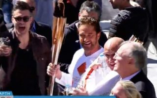 big-crowds-force-hoc-to-suspend-olympic-torch-relay-in-greece