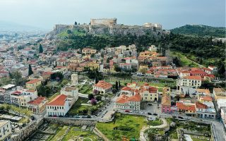 The Acropolis and a deserted Plaka, a popular district with tourists in Athens, are seen during the lockdown last spring. The pandemic has taken a hefty toll on earnings from Airbnb bookings in the Greek capital. [Thanassis Stavrakis/AP]