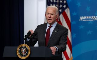 US President Joe Biden announces changes to the main US coronavirus disease aid program for small businesses during brief remarks in the South Court Auditorium at the White House in Washington, US, February 22, 2021. [Jonathan Ernst/Reuters]