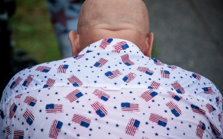 A man in a patriotic shirt during the 'Salute to America' event on the Fourth of July on the National Mall in Washington, July 4, 2019. [Damon Winter/The New York Times]
