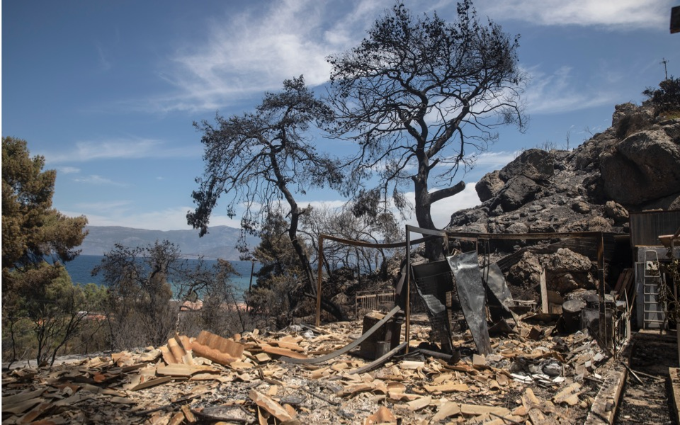 A damaged house from a wildfire, in the village of Vamvakies, Corinth, Greece, Thursday, May 20, 2021. [Petros Giannakouris/AP]