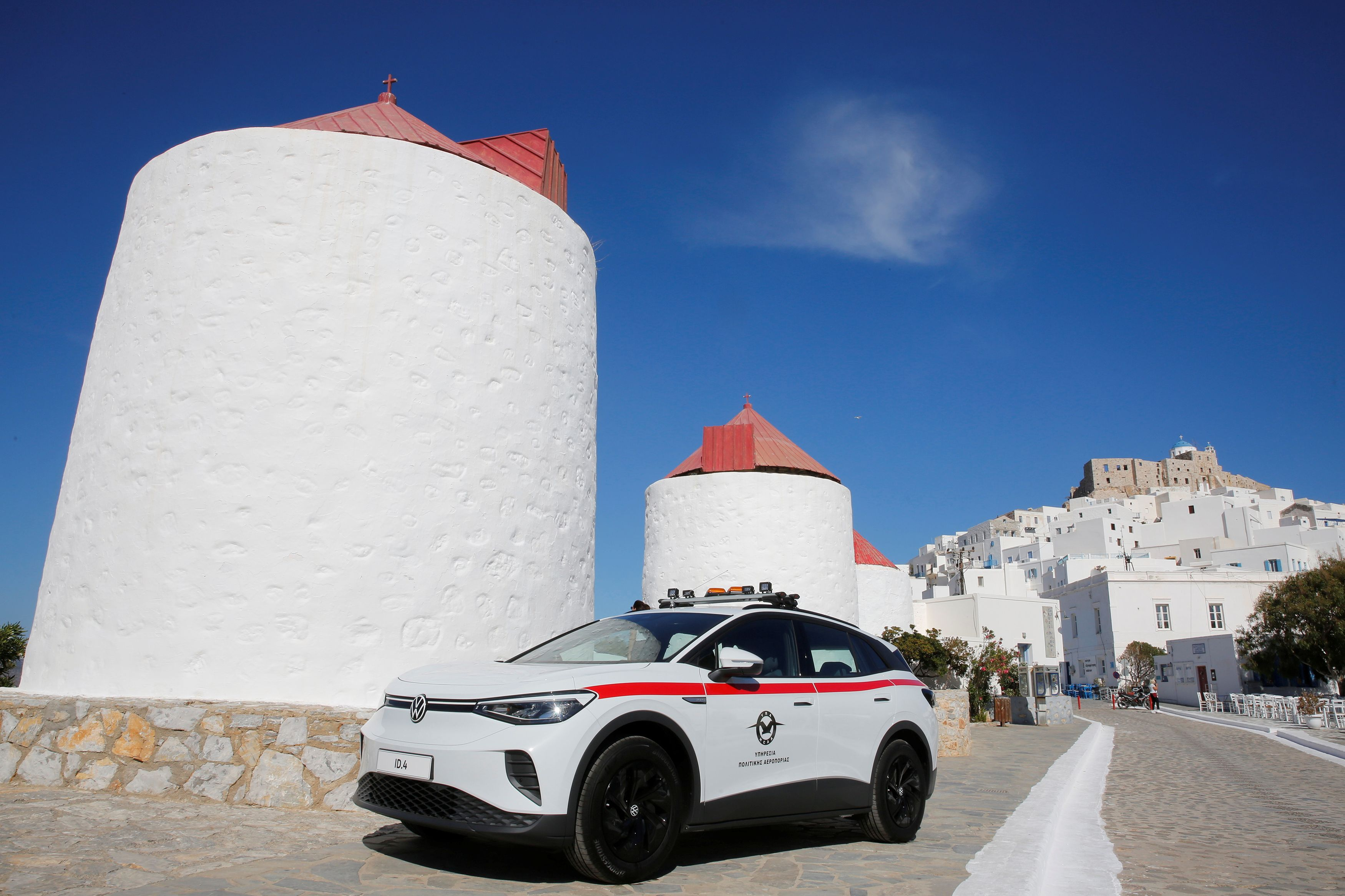 A Volkswagen ID.4 electric cars is seen during a delivery ceremony of service cars and chargers to the police and the port authority of the island of Astypalea, Greece, June 2, 2021. [Alexandros Vlachos/Pool via Reuters]