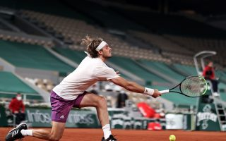 steely-tsitsipas-keeps-cool-to-beat-isner-in-four-sets