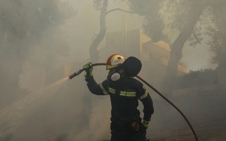 wildfire-tears-through-forest-near-athens-homes-damaged