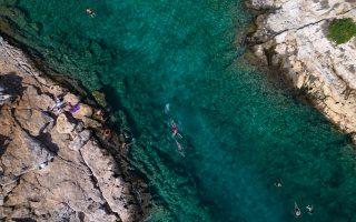 sun-seekers-enjoy-european-summer-workcation-before-office-return