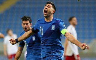 late-bakasetas-and-pelkas-strikes-give-greece-victory-in-georgia